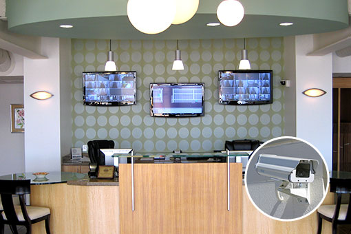 Video surveillance cameras stream to monitors in the manager's office.