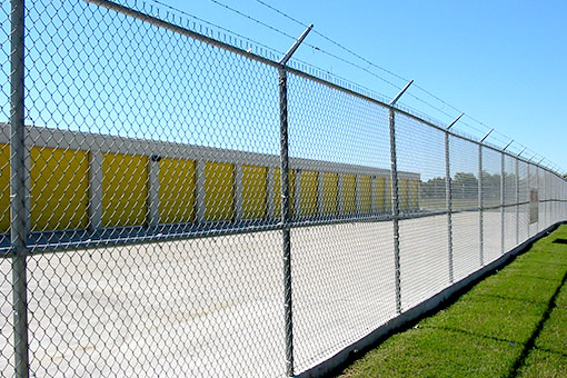 8' barbed-wire security fences surround the perimeter.